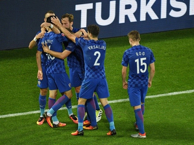 Nikola Kalinic celebrates scoring his team's first goal with his teammates during the Euro 2016 Group D match between Croatia and Spain on June 21, 2016