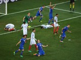 Iceland players celebrate while England players show dejection after the UEFA EURO 2016 round of 16 match between England and Iceland at Allianz Riviera Stadium on June 27, 2016 in Nice, France