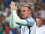 Wayne Rooney of England applauds the supporters after his team's 1-2 defeat in the UEFA EURO 2016 round of 16 match between England and Iceland at Allianz Riviera Stadium on June 27, 2016 in Nice, France