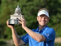 Billy Hurley III holds up the trophy after the final round of the Quicken Loans National at Congressional Country Club in Bethesda, Maryland on June 26, 2016