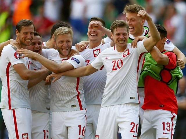 Assorted Poles celebrate after winning the Euro 2016 RO16 match between Switzerland and Poland on June 25, 2016