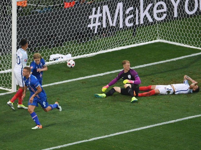 Ragnar Sigurdsson (2nd L) of Iceland celebrates scoring his team's first goal during the UEFA EURO 2016 round of 16 match between England and Iceland at Allianz Riviera Stadium on June 27, 2016 in Nice, France