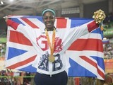 Kadeena Cox poses with her gold medal and the GB flag after winning the women's C4-5 500m time trial at the Paralympic Games in Rio de Janeiro on September 10, 2016