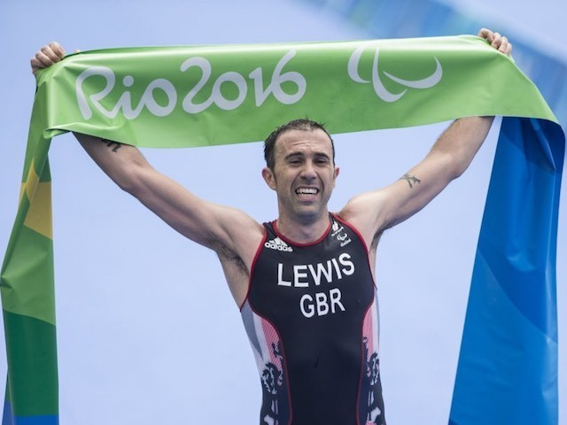 Andy Lewis celebrates winning gold in the men's triathlon at the Paralympic Games in Rio de Janeiro on September 10, 2016