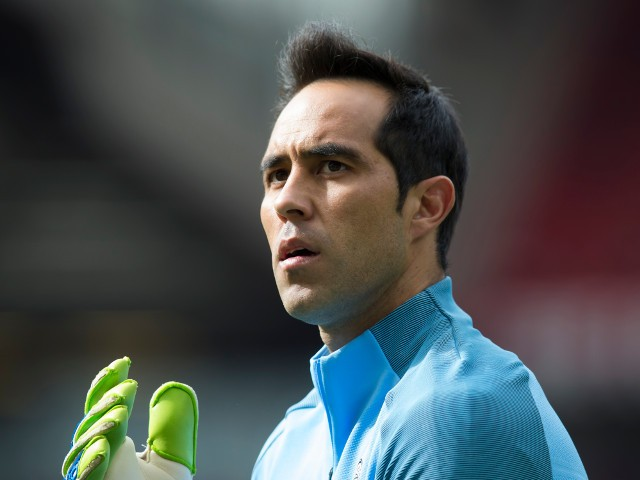 Manchester City goalkeeper Claudio Bravo warms up ahead of his debut against Manchester United at Old Trafford on September 10, 2016