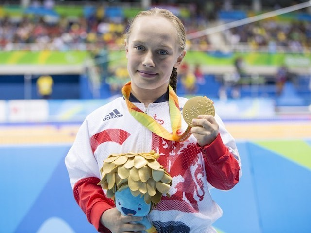 Ellie Robinson celebrates with her gold medal earned in the women's 50m butterfly S6 at the Paralympic Games in Rio on September 9, 2016