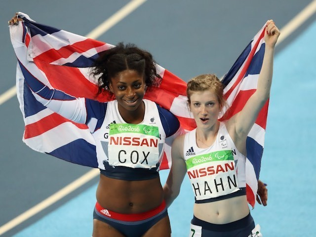Kadeena Cox and Sophie Hahn pose with the British flag after taking silver and gold in the women's T38 100 final at the Rio Paralympics on September 9, 2016
