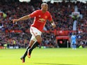 Manchester United forward Anthony Martial does a better celebration after scoring during his side's Premier League clash with Stoke City at Old Trafford on October 2, 2016