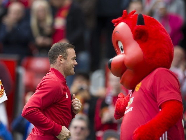 Wayne Rooney talks tactics with the United mascot on September 24, 2016