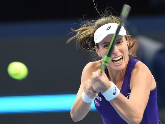 Johanna Konta of Britain hits a return to Agnieszka Radwanska of Poland at the China Open on October 9, 2016