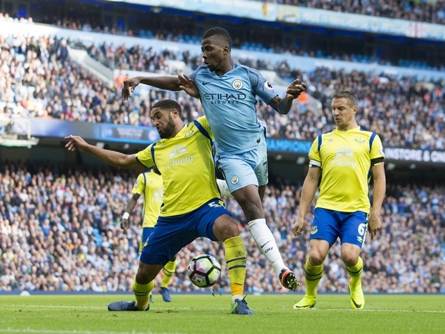 Kelechi Iheanacho attempts to score with a backheel despite the attentions of Everton defender Ashley Williams on October 15, 2016