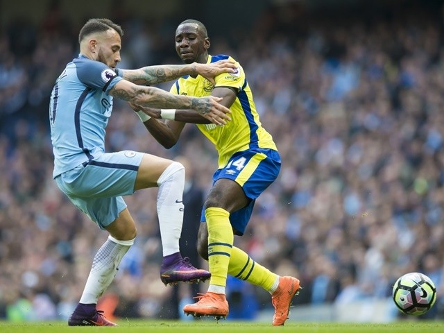 Manchester City defender Nicolas Otamendi fights for the ball against Everton midfielder Yannick Bolasie on October 15, 2016
