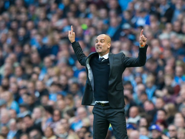 Manchester City manager Pep Guardiola gestures during his side's Premier League match against Everton at the Etihad Stadium on October 15, 2016