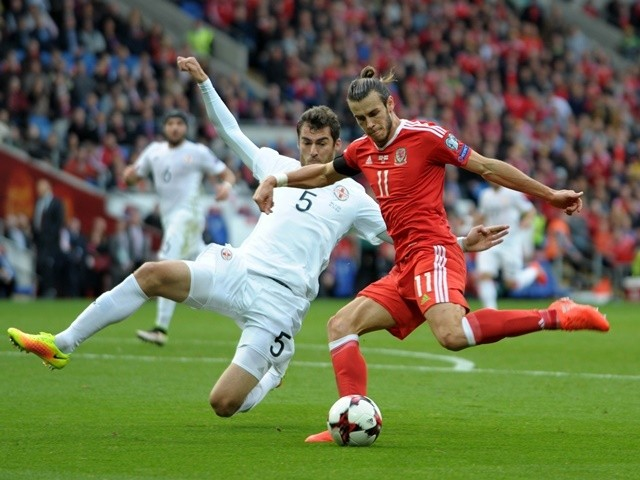 Georgia's Solomon Kvirkvelia dives in to tackle Wales's Gareth Bale during the 2018 World Cup Qualifier match on 9 October 2016