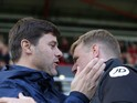 Tottenham Hotspur manager Mauricio Pochettino meets Bournemouth boss Eddie Howe prior to their sides' Premier League clash at the Vitality Stadium on October 22, 2016