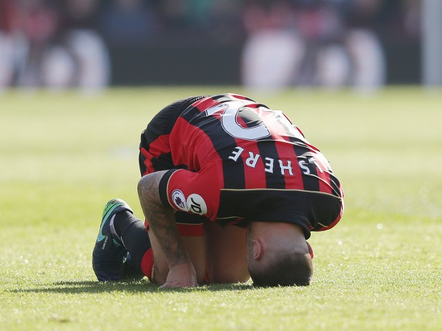 Jack Wilshere laments his ribs during his side's Premier League clash with Tottenham Hotspur at the Vitality Stadium on October 22, 2016
