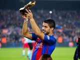 Barcelona forward Luis Suarez proudly holds aloft his Golden Boot prior to his side's La Liga clash with Granada on October 29, 2016