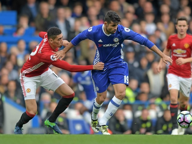 Chris Smalling mistimes his grab of Diego Costa's crotch during the Premier League game between Chelsea and Manchester United on October 23, 2016