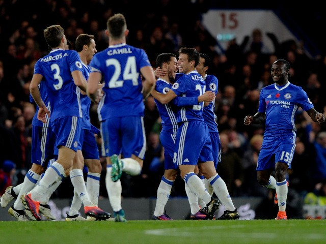Eden Hazard celebrates with Chelsea teammates after scoring during his side's victory over Everton at Stamford Bridge on November 5, 2016