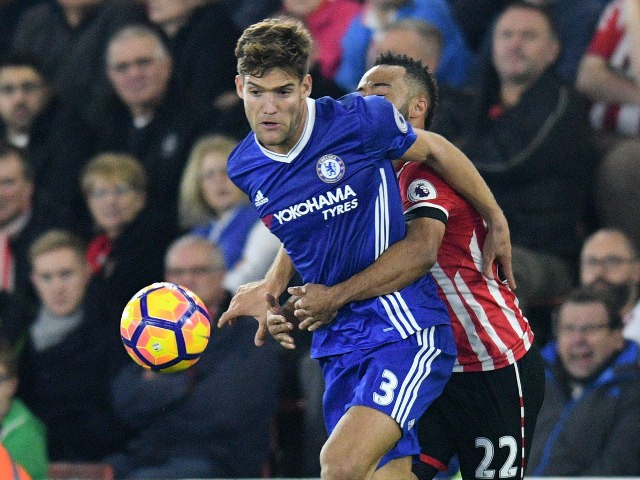 Marcos Alonso of Chelsea holds off the challenge of Nathan Redmond during his side's Premier League clash with Southampton at St Mary's on October 30, 2016