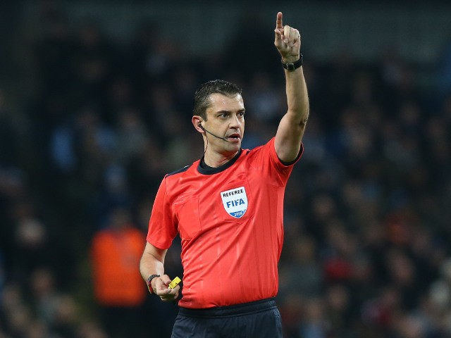 Referee Viktor Kassai in action during the Champions League clash between Manchester City and Barcelona at the Etihad Stadium on November 1, 2016