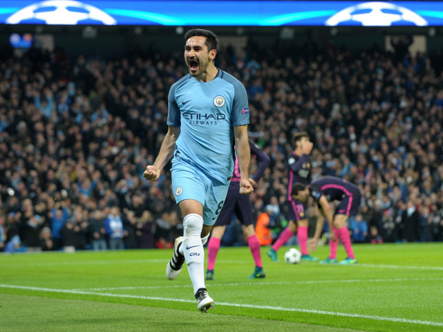Manchester City midfielder Ilkay Gundogan peels away to celebrate after scoring during his side's Champions League clash with Barcelona at the Etihad Stadium on November 1, 2016