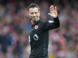 Referee Mark Clattenburg gestures during the North London derby between Arsenal and Tottenham Hotspur at the Emirates Stadium on November 6, 2016