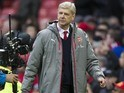 Arsene Wenger shows off his Winter 2016 look during the Premier League game between Manchester United and Arsenal on November 19, 2016