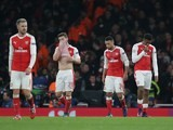 An assortment of Arsenal players react at the end of their Champions League game against PSG on November 23, 2016