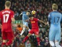 Roberto Firmino battles with John Stones during the Premier League game between Liverpool and Manchester City on December 31, 2016
