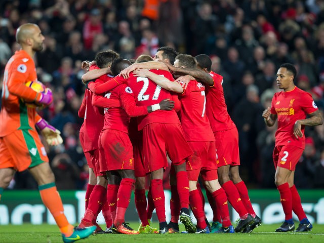 Liverpool players celebrate after an own goal by Stoke City's Giannelli Imbula during the Premier League clash between the two sides an Anfield on December 27, 2016