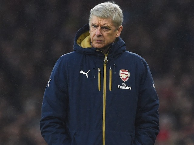 Arsene Wenger wraps up warm during the game between Arsenal and Newcastle on January 2, 2016