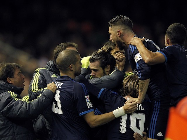 Gareth Bale is mobbed by teammates after scoring during the game between Valencia and Real Madrid on January 3, 2016