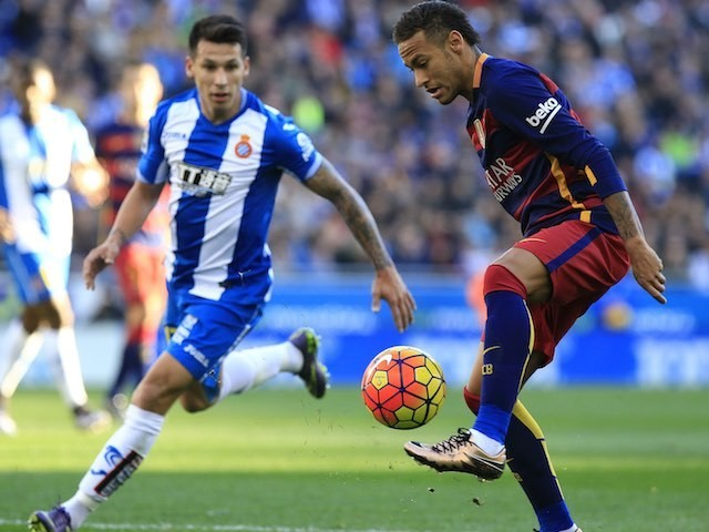 Neymar and Hernan Perez in action during the game between Espanyol and Barcelona on January 2, 2016
