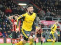 Arsenal striker Olivier Giroud celebrates after scoring a late equaliser during his side's Premier League clash with Bournemouth at the Vitality Stadium on January 3, 2017