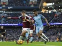 Raheem Sterling battles with Matthew Lowton during the Premier League game between Manchester City and Burnley on January 2, 2017