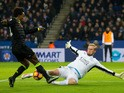 Leicester City goalkeeper Kasper Schmeichel tries to stop Chelsea winger Willian during the Premier League clash between the two sides on January 14, 2017