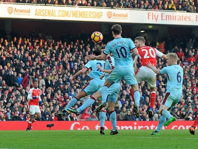 Shkodran Mustafi heads in the opener during the Premier League game between Arsenal and Burnley on January 22, 2017