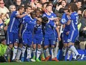 Eden Hazard is mobbed by teammates after scoring during the Premier League game between Chelsea and Arsenal on February 4, 2017