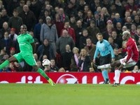 Paul Pogba and Florentin Pogba in action during the Europa League match between Manchester United and Saint-Etienne on February 16, 2017