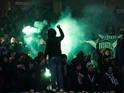 Saint-Etienne fans let off flares during the Europa League clash with Manchester United at Old Trafford on February 16, 2017