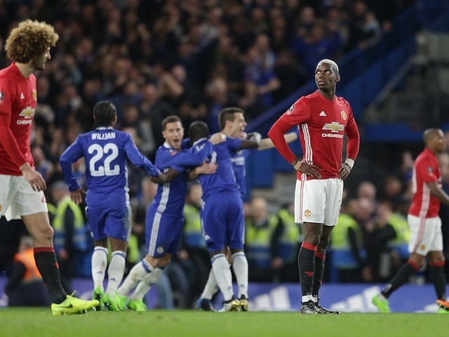 N'Golo Kante celebrates scoring as Paul Pogba watches on during the FA Cup quarter-final between Chelsea and Manchester United on March 13, 2017