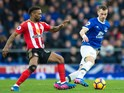 Everton midfielder Morgan Schneiderlin keeps the ball away from Sunderland striker Jermain Defoe during their Premier League clash at Goodison Park on February 25, 2017