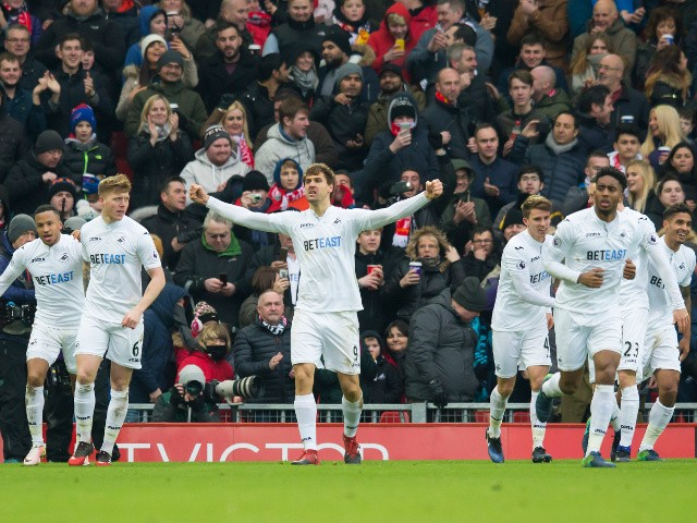 Swansea City striker Fernando Llorente celebrates after scoring during his side's Premier League clash with Liverpool at Anfield on January 21, 2017
