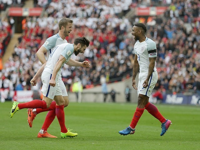 Jermain Defoe celebrates scoring with Eric Dier and Adam Lallana during the World Cup qualifier between England and Lithuania on March 26, 2017
