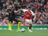 Alexis Sanchez and Yaya Toure during the Premier League match between Arsenal and Manchester City on April 2, 2017