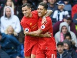 Roberto Firmino celebrates scoring with Philippe Coutinho during the Premier League game between West Bromwich Albion and Liverpool on April 16, 2017
