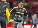 Alexis Sanchez warms up before the Premier League game between Middlesbrough and Arsenal on April 17, 2017