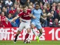 Middlesbrough's Ben Gibson and Manchester City's Raheem Sterling in action in the FA Cup quarter-final on March 11, 2017