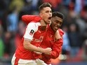 Arsenal's Gabriel Paulista and Alex Iwobi celebrate victory over Manchester City in the FA Cup semi-final on April 23, 2017